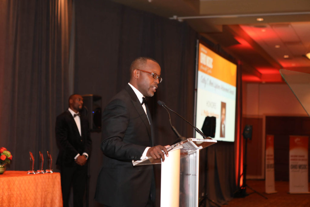 TriVersity CEO Mel Gravely introduces award winner J. Phillip Holloman at the 2018 Annual Awards Gala on November 16 at the Savannah Center in West Chester, Ohio.